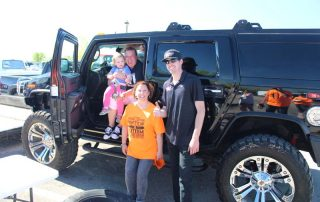 family in front of jeep