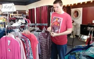 young man working in a clothing store