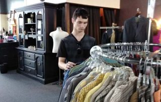 young man sorting clothes