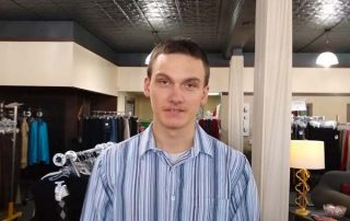 young man in a clothing store