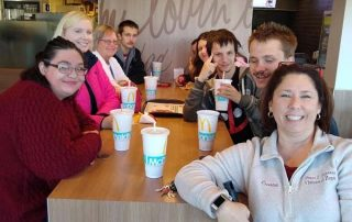 group of people eating at McDonald's