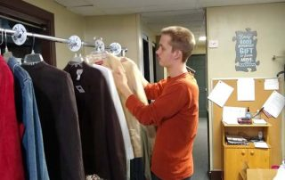student sorting clothes
