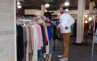 two young men sorting clothes