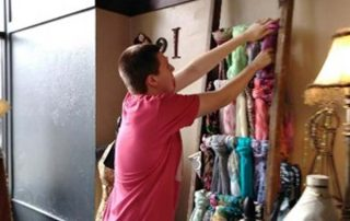 young man organizing fabric